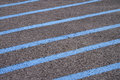 Blue lines on pavement painted of for handicap parking area Royalty Free Stock Photos