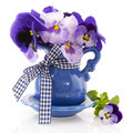 Blue little vase pansies Stock Photography