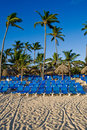 Blue lounges on a sand beach Royalty Free Stock Photo
