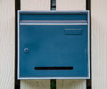 Blue mail box with locked in front of house Royalty Free Stock Photos