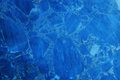Blue marble texture background pattern useful as or Royalty Free Stock Image