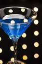 Blue martini cocktail in an disco setting Royalty Free Stock Photo