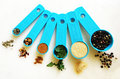 Blue Measuring spoons with spices Royalty Free Stock Photo