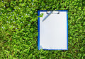 Blue medical clipboard over green grass Royalty Free Stock Photo