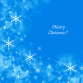 Blue merry christmas background with snowflakes a Stock Photography