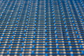 Blue metal mesh texture with rectangular holes Royalty Free Stock Photo
