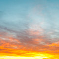 Blue morning sky over yellow sunrise clouds light bright in autumn Royalty Free Stock Image