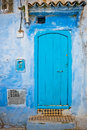 Blue moroccan style door a in a village in chefchouaen morocco north africa Stock Photo