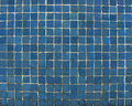 Blue mosaic tiles on a wall Royalty Free Stock Photos