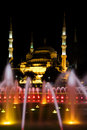 Blue mosque with fountain at night istanbul turkey Stock Images