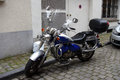 Blue motorcycle in the city; Royalty Free Stock Photo