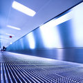 Blue moving escalator in the office hall Stock Photography