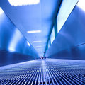 Blue moving escalator in the office hall Royalty Free Stock Photos