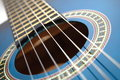 Blue music guitar for playing party music Royalty Free Stock Image