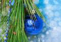 Blue necklace and a ball on christmas tree decoration branch Stock Photography