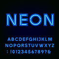 Blue neon light alphabet font. Royalty Free Stock Photo