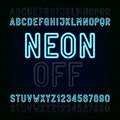 Blue Neon Light Alphabet Font. Two different styles. Lights on or off. Type letters and numbers. Royalty Free Stock Photo