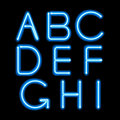 Blue neon light glowing letters set