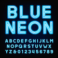 Blue neon tube alphabet font. Type letters and numbers on a dark background.