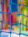 Blue net closeup in children playground. Colorful plastic backgr Royalty Free Stock Photo