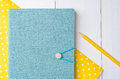 Blue notebook with color pencils on yellow paper Royalty Free Stock Photo