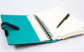 Blue notebook with pen Royalty Free Stock Photo