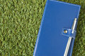 Blue notebook put on grass Royalty Free Stock Photo