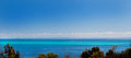 Blue ocean off the spanish coast panoramic view over low trees of tropical Royalty Free Stock Photos