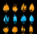 Blue and orange glowing flames on black background Royalty Free Stock Photos