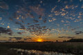 Blue and orange scenic sunset on the texas plains with reflective creek small clouds Royalty Free Stock Image