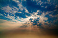 Blue and orange sunset sky with rays of light Royalty Free Stock Photo