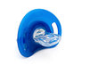 Blue pacifiers isolated on white with clipping path Stock Image