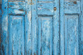 Blue Paint Peeling off Door (Texture) Royalty Free Stock Photo