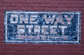Blue painted one way traffic street sign Royalty Free Stock Photo