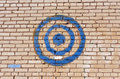 Blue painted target on brick wall. Royalty Free Stock Photo