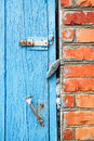 Blue painted wooden door with latches old close up Royalty Free Stock Image