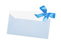 Blue paper envelope with bow isolated on white background Stock Images