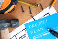 Blue paper with home improvement project plan, tools kit
