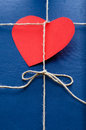 Blue paper package with valentine card or gift red heart shape Stock Photos