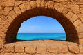 Blue paradise view of a sea through a window in an old fortification Royalty Free Stock Photography