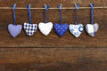 Blue pattern gingham love valentine s hearts hanging on wooden t natural cord and clips rustic driftwood texture background copy Royalty Free Stock Image