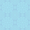 Blue pattern seamless with delicate snowflakes Royalty Free Stock Photography