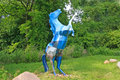 Blue patterned horse sculpture patterened rearing up on hind legs Stock Photo
