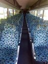 Blue patterned tour bus interior seats Royalty Free Stock Photo