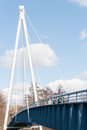 Blue pedestrian suspension bridge connecting the old town island of berlin köpenick Stock Photo