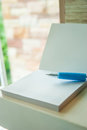 A blue pen put on white blank paper for write down massage Stock Photography