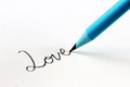 Blue pencil and cursive word love Stock Images