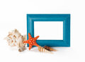 Blue photoframe with seashells near it isolated on white background Stock Photography