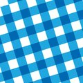 Blue picnic cloth with some squares in it Royalty Free Stock Photo