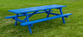 Blue picnic table a on green grass Royalty Free Stock Photo